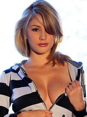 busting out of her black and white striped top